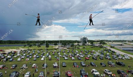 (EDITORS NOTE: image taken with a drone) High wire artists Nik Wallenda (right) and Blake Wallenda perform at Nik Wallenda's Daredevil Rally, billed as the world's first drive-in stunt show at Nathan Benderson Park.  The show, which runs on selected dates through June 21, features internationally known daredevil performers and is designed to be a safe event during the coronavirus pandemic, with the separation of spectator's vehicles according to social distancing guidelines.