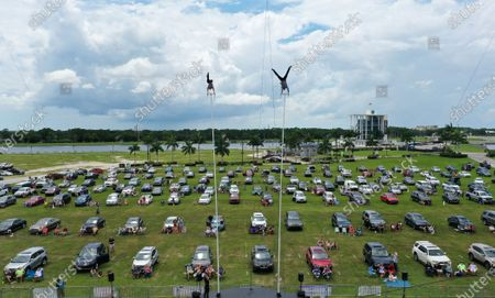 (EDITORS NOTE: image taken with a drone) Erendira Wallenda (left) and Alec Bryant perform on the sway poles at Nik Wallenda's Daredevil Rally, billed as the world's first drive-in stunt show, at Nathan Benderson Park. The show, which runs on selected dates through June 21, features internationally known daredevil performers and is designed to be a safe event during the coronavirus pandemic, with the separation of spectator's vehicles according to social distancing guidelines.