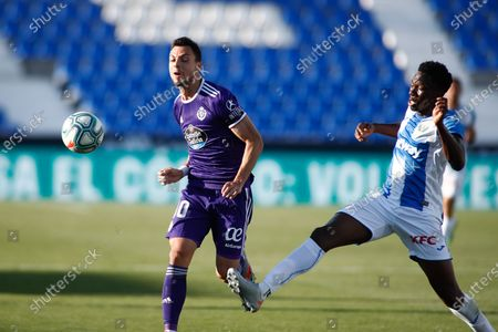 Oscar Plano of Valladolid and Kenneth Omeruo of Leganes in action
