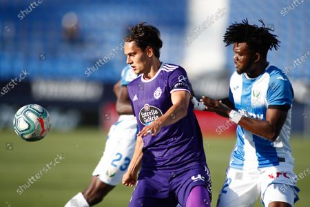 Stock Photo of Enes Unal of Valladolid and Chidozie Awaziem of Leganes in action