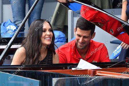 Stock Image of 12.06.2020, , Belgrad, SBR, Tennis, Adria Tour ,  Pianistin Lola Astanova and Novak Djokovic