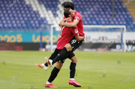 Hannover's Edgar Prib celebrates with team mate Genki Haraguchi (R) scoring the 1-1 goal during the German Bundesliga Second Division soccer match between SV Darmstadt 98 and Hannover 96 at Merck-Stadion in Darmstadt, Germany, 14 June 2020.