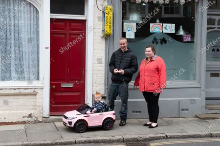 A Sunday trip out for this family with a remote controlled car for their little girl as more people are out and about in the  town following the easing of the Coronavirus Covid-19 Pandemic lockdown rules