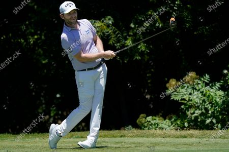 Stock Image of Branden Grace, of South Africa, watches his tee shot on the sixth hole during the final round of the Charles Schwab Challenge golf tournament at the Colonial Country Club in Fort Worth, Texas