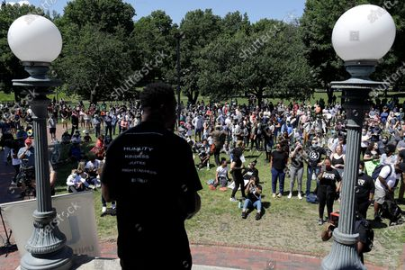 """Benjamin Watson, a former New England Patriots football player, front, addresses an audience during an event called """"Boston Pray: Seeking Unity and Justice"""" held to call for end to racial injustice, in Boston, triggered by the death of George Floyd, an African American man who died on May 25 as a Minneapolis police officer pressed his knee into his neck"""