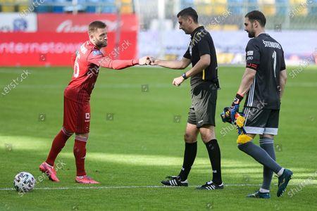 Jakub Blaszczykowski of Wisla (L) and referee Krzysztof Jakubik speak during the Polish Ekstraklasa match between Arka Gdynia and Wisla Krakow. (Final score; Arka Gdynia 0:0 Wisla Krakow)