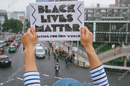 Thousands of protesters walk on the street during a Black Lives Matter protest in Shibuya shopping district in Tokyo, Japan. Following the death of George Floyd, Black Lives Matter protest take all over the world.