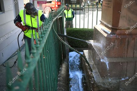 A worker uses a pressure hose to remove graffiti on a Captain Cook statue at Randwick in Sydney, Australia, 15 June 2020. Captain James Cook was an officer in the British Royal Navy who is often credited with discovering Australia.