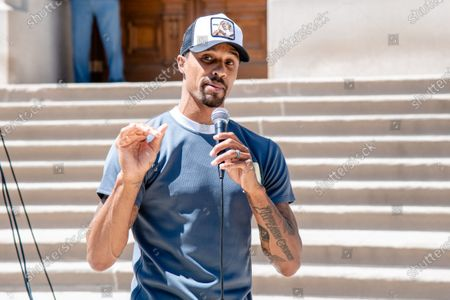 NBA player George Hill speaks as Protestors gathered at 'Black Women In Charge, The Monumental March & Voter Registration' rally in support of Black Lives Matter at the Indianapolis State Capitol. Protestors have gathered for demonstrations around the country in solidarity with Minneapolis following the death of George Floyd.