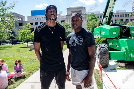 NBA Players Justin Holiday (L) & Aaron Holiday pose for a photo as protestors gathered at 'Black Women In Charge, The Monumental March & Voter Registration' rally in support of Black Lives Matter at the Indianapolis State Capitol. Protestors have gathered for demonstrations around the country in solidarity with Minneapolis following the death of George Floyd.