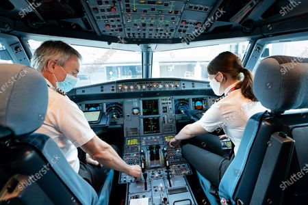 Captain David Morgan, Director of Flight Operations and Captain Kate McWilliams during a safety check on board easyJet flight EZY883 this morning from London Gatwick to Glasgow, the flight is the airline's first from the UK for 76 days, since easyJet grounded all planes on March 30th as a result of the Covid-19 pandemic, the airline resumes flying today from 8 UK airports with new bio security measures in place on all its services. easyJet's first ever flight from London-Luton to Glasgow took off on 10 November 1995.