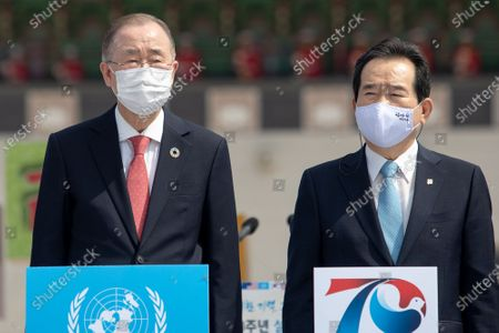 Ban Ki-moon, left, former Secretary-General of the United Nations, South Korean Prime Minister Chung Sye-kyun, right, attend the 70th anniversary of the Korean War in Seoul, South Korea.
