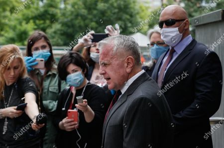 US Ambassador to Russia John Sullivan (front) speaks to media after verdict announcement to US citizen Paul Whelan in espionage case at the Moscow City Court in Moscow, Russia, 15 June 2020. Whelan, a former police officer who holds quadruple citizenship of the United States, Britain, Canada and Ireland, was arrested on suspicion of being a foreign spy by Russia's Federal Security Service (FSB) in late December 2018 in Moscow. The court found him guilty and sentenced Whelan to 16 years' imprisonment in a high-security penitentiary with the possibility of serving time in a labor camp.