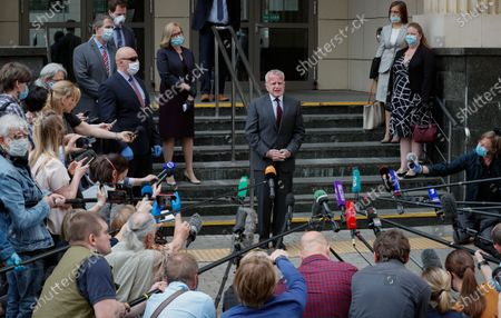 US Ambassador to Russia John Sullivan (C) speaks to media after verdict announcement to US citizen Paul Whelan in espionage case at the Moscow City Court in Moscow, Russia, 15 June 2020. Whelan, a former police officer who holds quadruple citizenship of the United States, Britain, Canada and Ireland, was arrested on suspicion of being a foreign spy by Russia's Federal Security Service (FSB) in late December 2018 in Moscow. The court found him guilty and sentenced Whelan to 16 years' imprisonment in a high-security penitentiary with the possibility of serving time in a labor camp.