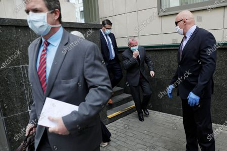 Ambassador to Russia John Sullivan, 2nd right, leaves the Moscow City Court building after the verdict announcement for American Paul Whelan in Moscow, Russia, . The Moscow City Court on Monday convicted Paul Whelan on charges of espionage and sentenced him to 16 years in maximum security prison colony. Whelan has insisted on his innocence, saying he was set up. The U.S. Embassy has denounced Whelan's trial as unfair, pointing that no evidence has been provided