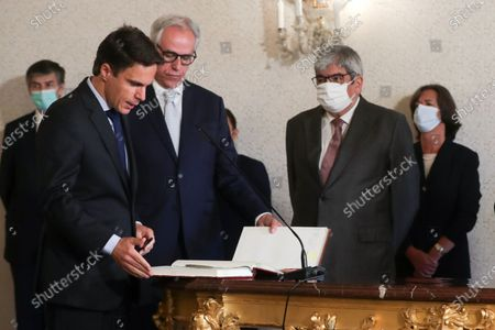 The new Secretary of State for Finance Joao Nuno Mendes (L) is sworn in during the taking office ceremony at Belem Palace in Lisbon, Portugal, 15 June 2020. This is the first remodelling of the XXII Government, and was triggered by the departure of Mario Centeno from the position of Minister of State and Finance, at his request. The new Minister of State and Finance, Joao Leao, and the new Secretaries of State for the Budget, Claudia Joaquim, of Finance, Joao Nuno Mendes, and Treasury, Miguel Cruz and the Assistant Secretary of State and Finance, Antonio Mendonca Mendes, take office at the ceremony.