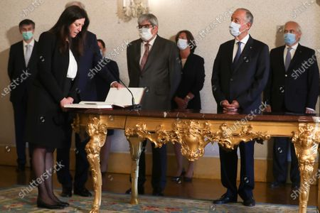 The new Secretary of State for the Budget Claudia Joaquim (L) is sworn in during the taking office ceremony at Belem Palace in Lisbon, Portugal, 15 June 2020. This is the first remodelling of the XXII Government, and was triggered by the departure of Mario Centeno from the position of Minister of State and Finance, at his request. The new Minister of State and Finance, Joao Leao, and the new Secretaries of State for the Budget, Claudia Joaquim, of Finance, Joao Nuno Mendes, and Treasury, Miguel Cruz and the Assistant Secretary of State and Finance, Antonio Mendonca Mendes, take office at the ceremony.