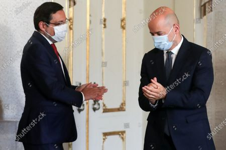The new Minister of State and Finance Joao Leao (R) and the new Assistant Secretary of State and Tax Affairs Antonio Mendonca Mendes (L) disinfect their hands after taking office ceremony at Belem Palace in Lisbon, Portugal, 15 June 2020. This is the first remodelling of the XXII Government, and was triggered by the departure of Mario Centeno from the position of Minister of State and Finance, at his request. The new Minister of State and Finance, Joao Leao, and the new Secretaries of State for the Budget, Claudia Joaquim, of Finance, Joao Nuno Mendes, and Treasury, Miguel Cruz and the Assistant Secretary of State and Finance, Antonio Mendonca Mendes, take office at the ceremony.