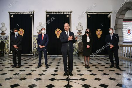 The new Minister of State and Finance Joao Leao (C) accompanied by the new Secretary of State for Finance Joao Nuno Mendes (L),  the new Assistant Secretary of State and Tax Affairs Antonio Mendonca Mendes (2-L), the new Secretary of State for the Budget Claudia Joaquim (2-R) and the new Secretary of State for the Treasury Miguel Cruz (R) speaks to journalists after the taking office ceremony at Belem Palace in Lisbon, Portugal, 15 June 2020. This is the first remodelling of the XXII Government, and was triggered by the departure of Mario Centeno from the position of Minister of State and Finance, at his request. The new Minister of State and Finance, Joao Leao, and the new Secretaries of State for the Budget, Claudia Joaquim, of Finance, Joao Nuno Mendes, and Treasury, Miguel Cruz and the Assistant Secretary of State and Finance, Antonio Mendonca Mendes, take office at the ceremony.