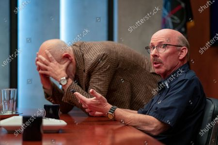 John Malkovich as Dr. Adrian Mallory and Don Lake as Brad Gregory