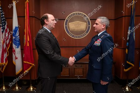 Stock Picture of Dan Bakkedahl as John Blandsmith and Steve Carell as General Mark R. Naird