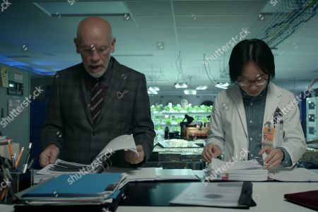 John Malkovich as Dr. Adrian Mallory, Exie Booker as Dr. Carter and Jimmy O. Yang as Dr. Chan Kaifang