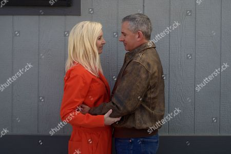Stock Photo of Lisa Kudrow as Maggie Naird and Steve Carell as General Mark R. Naird