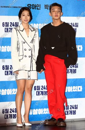 Park Shin-hye (L) and Yoo Ah-in (R) pose for the media ahead of the screening of the new zombie thriller '#Alive' at a movie theater in Seoul, 15 June 2020. The movie is to be released on 24 June in cinemas in South Korea.