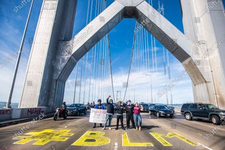 Protestors shut down the westbound direction of the Bay Bridge toward San Francisco, California after the death of George Floyd.