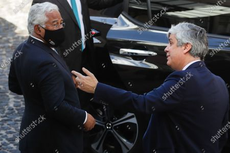 Portuguese Prime Minister Antonio Costa (L) speaks with former Minister of State and Finance Mario Centeno (R) after the taking office ceremony of the new Finance Minister and new Secretaries of State, in Lisbon, Portugal, 15 June 2020. This is the first remodelling of the XXII Government, and was triggered by the departure of Mario Centeno from the position of Minister of State and Finance, at his request. The new Minister of State and Finance, Joao Leao, and the new Secretaries of State for the Budget, Claudia Joaquim, of Finance, Joao Nuno Mendes, and Treasury, Miguel Cruz and the Assistant Secretary of State and Finance, Antonio Mendonca Mendes, take office at the ceremony.