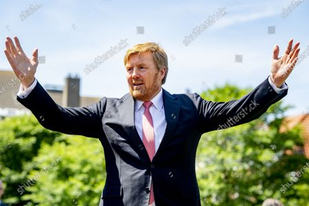 Stock Photo of King Willem-Alexander of the Netherlands chats with bicycle police officers during his visit to the Police Enforcement Team. The monarch met with the Extraordinary Investigating Officers (BOAs) and other law enforcement officials with whom the BOAs work closely together.
