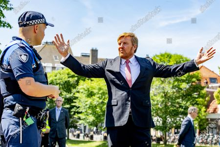 Stock Image of King Willem-Alexander of the Netherlands chats with bicycle police officers during his visit to the Police Enforcement Team. The monarch met with the Extraordinary Investigating Officers (BOAs) and other law enforcement officials with whom the BOAs work closely together.