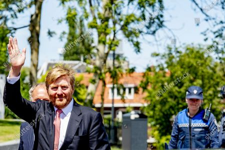Stock Picture of King Willem-Alexander of the Netherlands chats with bicycle police officers during his visit to the Police Enforcement Team. The monarch met with the Extraordinary Investigating Officers (BOAs) and other law enforcement officials with whom the BOAs work closely together.