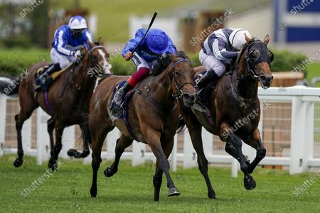 ASCOT, ENGLAND - JUNE 16: Ryan Moore riding Circus Maximus (R) win The Queen Anne Stakes from Frankie Dettori and Terebellum (blue) at Ascot Racecourse on Day 1 of the Royal Meeting on June 16, 2020 in Ascot, England. The Queen will miss out on attending Royal Ascot in person for the first time in her 68 year reign. Her Majesty is reported to be planning to watch the racing from home at Windsor Castle, but she will not be able to attend, as the meet goes on behind closed doors due to the Covid-19 pandemic. (Photo by Alan Crowhurst/Getty Images), Supplied by Hugh Routledge