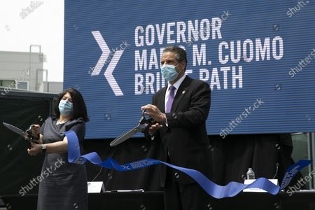New York Gov. Andrew Cuomo does a ceremonial ribbon cutting for the opening of a bicycle and pedestrian path across the Gov. Mario M. Cuomo Bridge, in Tarrytown, N.Y