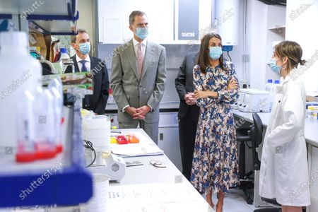 Stock Picture of King Felipe VI and Queen Letizia begin the visit in the Royal Cabinet of Natural History created by Carlos III and ended in the laboratories of Molecular Systematics.