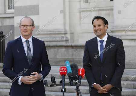 Irish Prime Minister Taoiseach and Fine Gael Leader Leo Varadkar(R) and Tanaiste and Fine Gael Deputy Leader Simon Coveney (L) speak to the media at Governemt Buildings Dublin, Ireland, 15 June 2020. Fine Gael, Fianna Fail and the Green Party have agreed to form a coalition to form the next government in Ireland after the general election last February. The deal will see rotating prime minister beginning with Fianna Fail leader Micheal Martin. The programme for governemnt wil now be voted on by the three political parties before the next meeting of the Irish Parliament on Tuesday 30 June.