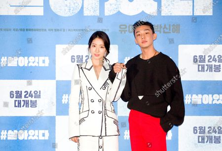 """South Korean actor Yoo Ah-In (R) and actress Park Shin-hye attend a press conference after a press preview of their new movie """"#Alive"""""""