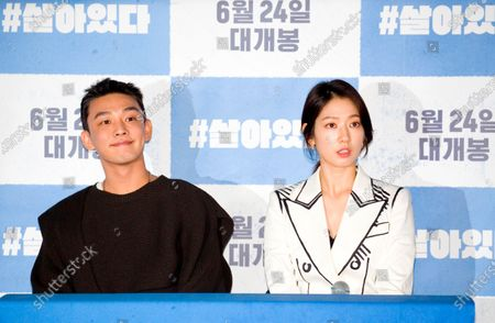 """South Korean actor Yoo Ah-In (L) and actress Park Shin-hye attend a press conference after a press preview of their new movie """"#Alive"""""""