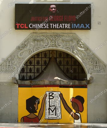 Black Lives Matter mural sits in a window of the TCL Chinese Theatre on Hollywood Blvd., a day after a large protest march there, in Los Angeles. Protests continue to be held in U.S. cities over the death of George Floyd, a black man who died after being restrained by Minneapolis police officers on May 25