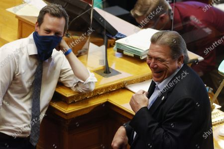 Stock Image of Colorado senators Steve Fenberg, D-Boulder, left, and Ray Scott, R-Grand Junction, joke with fellow senators in the Senate chambers as lawmakers try to wrap up the session in the State Capitol, in Denver