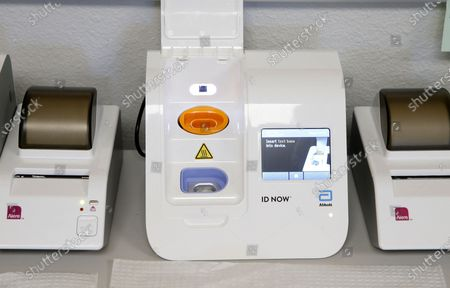 Stock Picture of Testing machine in a testing area set up by CVS at St. Vincent de Paul medical clinic, in Phoenix. The state Department of Health Services posted on its website Monday another 1,104 cases of COVID-19 and eight additional deaths, bringing the statewide total number of coronavirus cases to 36,705 and related deaths to 1,194