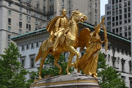 Stock Image of A general view of the golden equestrian statue of William Tecumseh Sherman, by sculptor by Augustus Saint-Gaudens, at Grand Army Plaza
