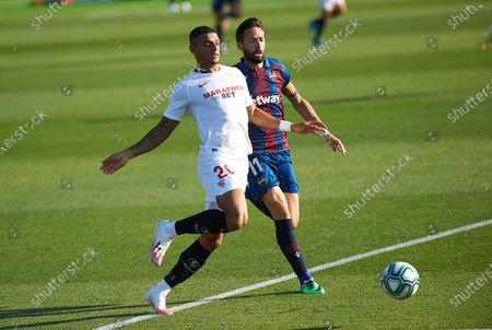 Jose Luis Morales of Levante and Diego Carlos Santos Silva of Sevilla