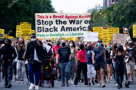 Protesters march before shutting down Interstate 395, a highway that runs through the nation's capital, during a protest to demand justice for George Floyd and for racial equality, in Washington, DC, USA, 15 June 2020. Protesters kneeled on the ground and forced traffic to stop. The death of George Floyd while in police custody in Minneapolis has sparked global protests demanding policing reform.