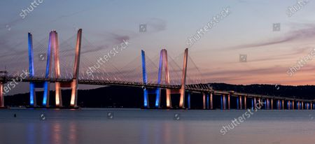 """Stock Photo of Bridge named after late Governor Mario Cuomo lit in blue in honor of his birthday and opening of pedestrian & bike riders path on the bridge in Tarrytown. Current Governor Andrew Cuomo, son of Mario Cuomo said that blue was favorite color of his father. Andrew Cuomo has opened a """"shared use path"""" for pedestrians and bike riders. The path is 3.6 miles long and features 6 scenic overlooks, public art and interactive displays."""