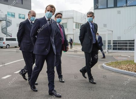 From left to right, Board Director of Sanofi Serge Weinberg, French President Emmanuel Macron, CEO of Sanofi Paul Hudson, and President of Sanofi France Olivier Bogillot arrive at the French drugmaker's vaccine unit Sanofi Pasteur plant in Marcy-l'Etoile, near Lyon, central France, .The visit comes after rival pharmaceutical company AstraZeneca this weekend announced a deal to supply 400 million vaccine doses to EU countries, including France