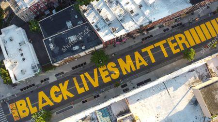 Black Lives Matter mural on the street