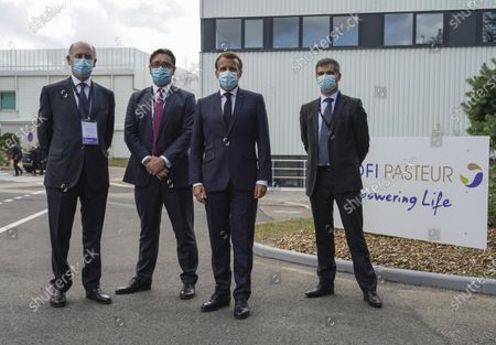 (L-R) Board Director of Sanofi Serge Weinberg, CEO of Sanofi Paul Hudson, French President Emmanuel Macron and President of Sanofi France Olivier Bogillot pose for a group photo at the French drugmaker's vaccine unit Sanofi Pasteur plant in Marcy-l'Etoile, near Lyon, central France, Tuesday, June 16, 2020.The visit comes after rival pharmaceutical company AstraZeneca this weekend announced a deal to supply 400 million vaccine doses to EU countries, including France.