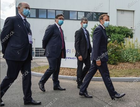 Board Director of Sanofi Serge Weinberg, CEO of Sanofi Paul Hudson, President of Sanofi France Olivier Bogillot French President Emmanuel Macron and arrive at the French drugmaker's vaccine unit Sanofi Pasteur plant in Marcy-l'Etoile, near Lyon, central France, Tuesday, June 16, 2020.The visit comes after rival pharmaceutical company AstraZeneca this weekend announced a deal to supply 400 million vaccine doses to EU countries, including France.